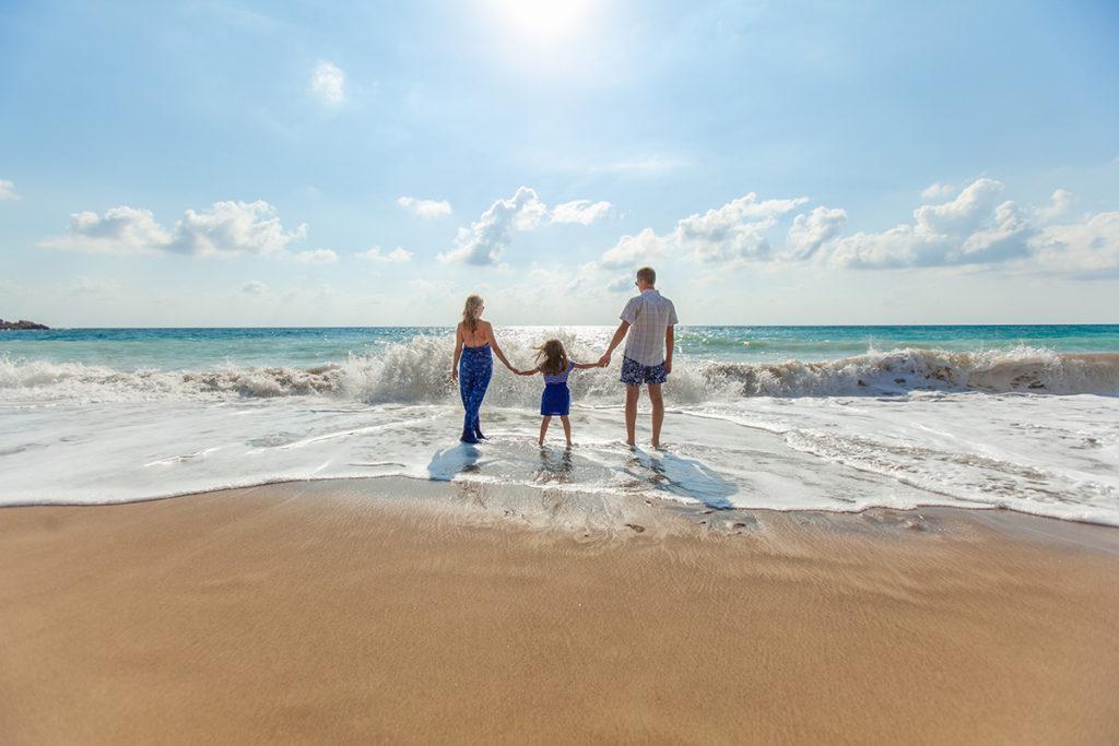 A family enjoys the beach
